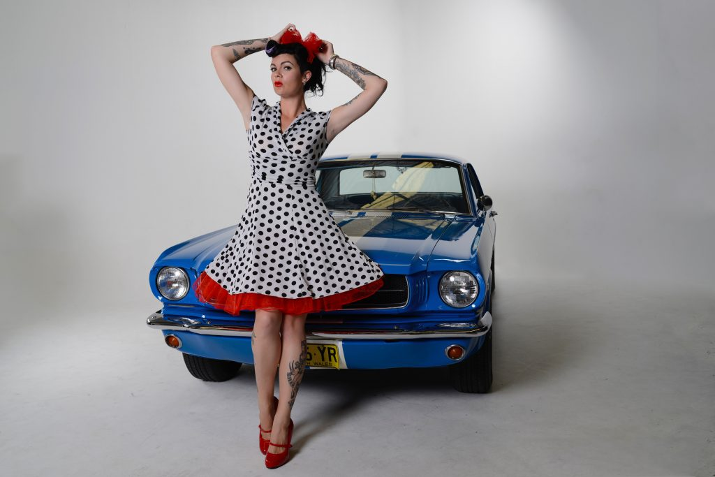 pinup girl with ford mustang retro betty